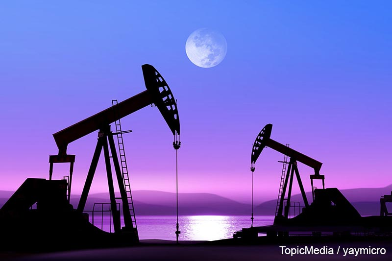 Working oil pump in deserted district in the bright of the moon