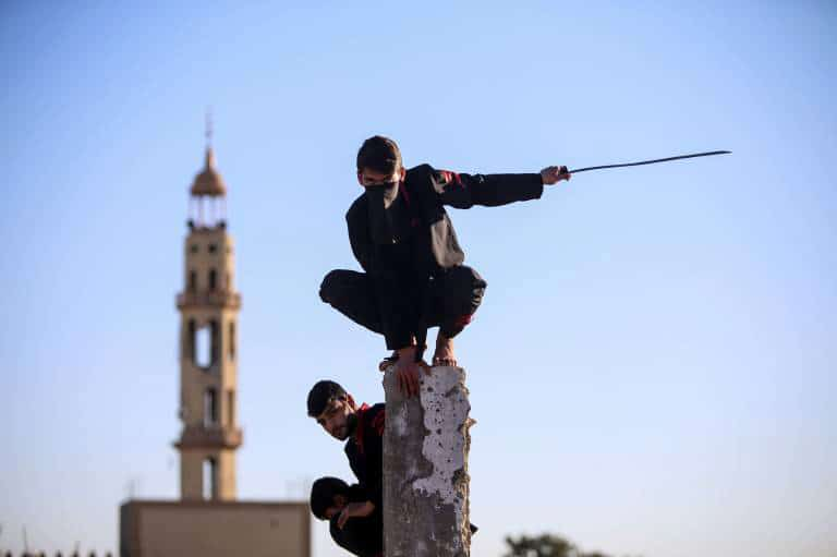 Ninja in Gaza 04 Feb 2016, Gaza, Gaza Strip, Palestinian Territory - A Palestinian youth demonstrates his ninja-style skills for the photographer in front of the ruins of buildings, that were destroyed in 2014 war, in the northern Gaza Strip January 29, 2016. The youths, who have been receiving martial arts training at local clubs in Gaza for the past two years, decided to form a team to hold regular shows in the hope that the publicity generated will eventually lead to them being invited to participate in international contests.. PUBLICATIONxINxGERxSUIxAUTxHUNxONLY Copyright: MohammedxAlxHajjar 00131233 Ninja in Gaza 04 Feb 2016 Gaza Gaza Strip PALESTINIAN Territory a PALESTINIAN Youth demonstrates His Ninja Style SKILLS for The Photo in Front of The Ruins of Buildings Thatcher Were destroyed in 2014 was in The Northern Gaza Strip January 29 2016 The Youths Who have been receiving Martial Arts Training AT Local Clubs in Gaza for The Past Two Years decided to Shape a Team to Hold Regular Shows in The Hope Thatcher The Publicity Generated will eventually Lead to THEM Being invited to participate in International Contests PUBLICATIONxINxGERxSUIxAUTxHUNxONLY Copyright MohammedxAlxHajjar 00131233