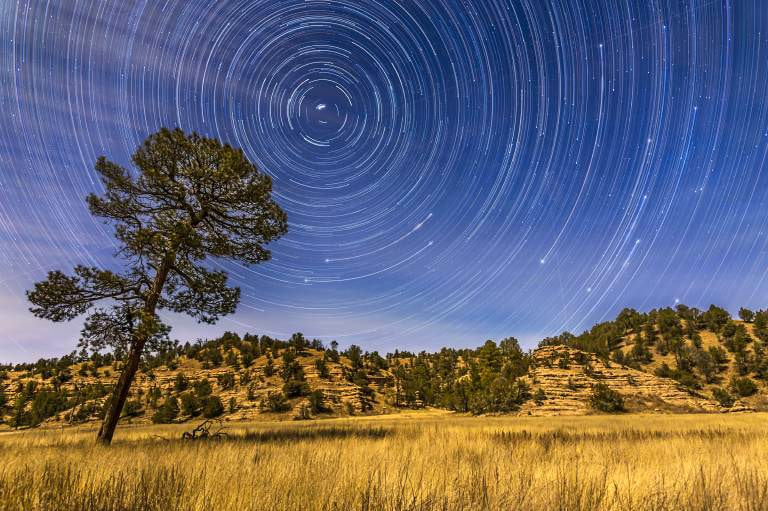 Circumpolar star trails over the moonlit Mimbres Valley near Lake Roberts in the Gila National Forest, in southwest New Mexico. Illumination is from the waxing gibbous moon. Polaris is at upper left, while the stars of the Big Dipper are rising at right, with just the BowlÖs Pointer stars visible at the start of the sequence, then rising to bring the entire Big Dipper above the horizon, with Alkaid, the end star of the handle, just clearing the ridge at right. PUBLICATIONxINxGERxSUIxAUTxONLY Copyright: AlanxDyer/StocktrekxImages ADY200220S circumpolar Star Trails Over The MoonLit Mimbres Valley Near Lake Roberts in The Gila National Forest in Southwest New Mexico Illumination IS from The waxing Crescent Moon Polaris IS AT Upper left while The Stars of The Big Dipper are Rising AT Right With Just The BowlÖs Pointer Stars Visible AT The Start of The Sequence Then Rising to bring The Entire Big Dipper above The Horizon With Alkaid The End Star of The handle Just Clearing The Ridge AT Right PUBLICATIONxINxGERxSUIxAUTxONLY Copyright AlanxDyer StocktrekxImages ADY200220S
