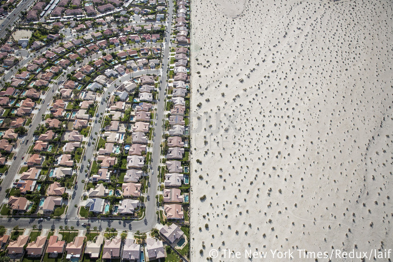 A housing development on the edge of undeveloped desert in Cathedral City, Calif.