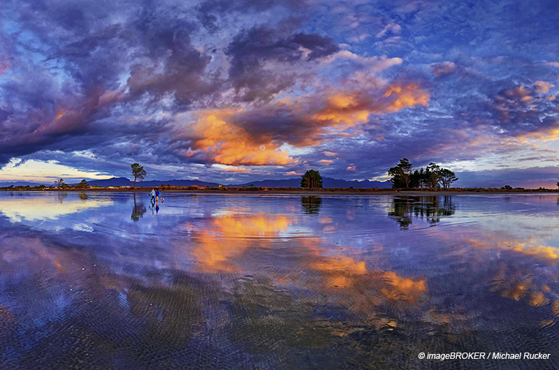 Panorama with glorious sunset at Carters Beach, cloudy sky, Water Reflection, Westport, West Coast, Southland, New Zealand, Oceania