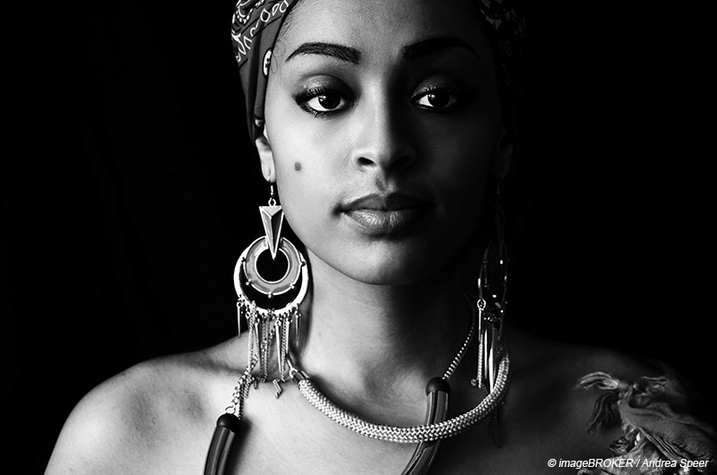 Portrait of a pretty woman with flashy jewelry in West Africa style